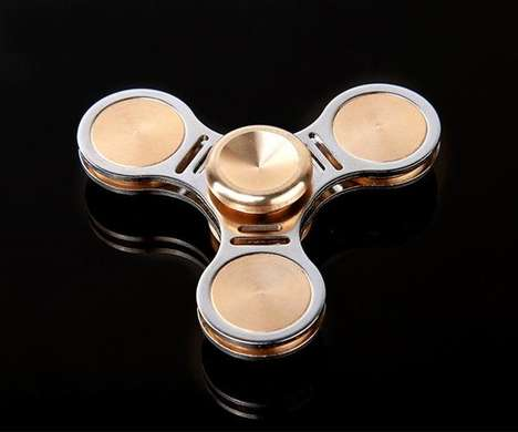 Whizzing Fidget Toys - The Fidget Hand Spinner Helps Fight Fidgeting Fingers