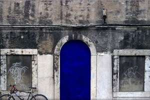 Lisbon Street Art Features Indigo Paint and Portuguese Poetry