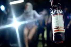 """Lady Gaga in """"Love Game"""" is Clearly Big on Campari"""