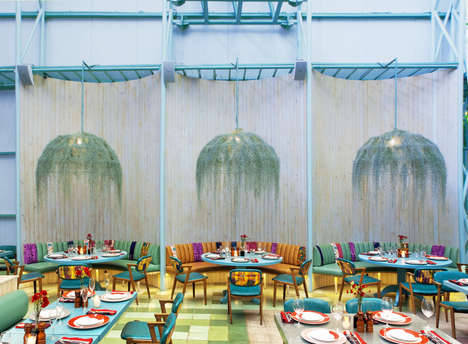 Vivid Tropical Eateries - The Madero Café Fuses Lush Greenery with Neon-Colored Beach Decor