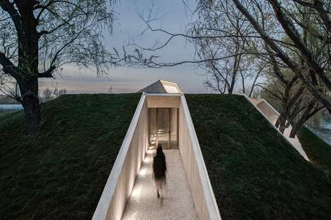 Embedded Buddhist Shrines - Arch Studio Carved This Shrine Into a Grassy Berm