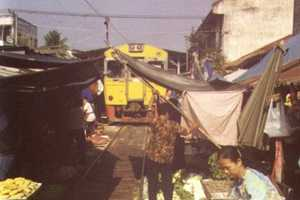 Thai Maeklong Market Takes Place On Train Tracks