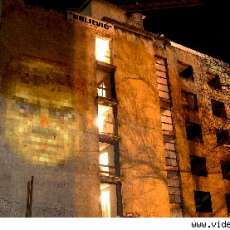 Urban Art Projection - Face of Doom Video Game Projected onto Decrepit Sarajevo Hotel