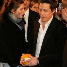 Hugh Grant Handcuffed by Fan at Premiere