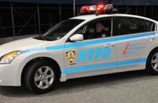 Green Police Cruisers - Altima Hybrids Hit the Streets of New York City
