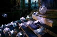 Evocative Trash Art - Illuminated Newspaper on Steps of Madrid Stock Exchange