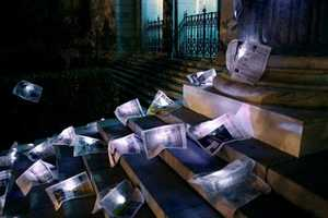 Illuminated Newspaper on Steps of Madrid Stock Exchange