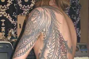 Rising Phoenix Tattoos as Statements of Rebirth