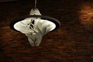 The Turbine Lamp Directs Peripheral Light Inwards and Out