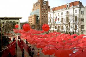 400 Red Umbrellas Suspend Over a Mall in Talca City
