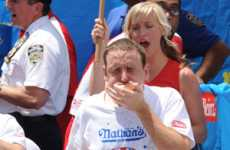 Pig-Down Competitions - Joey Chestnut Eats 68 Hots Dogs for a New World Record