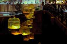 Birdcage Lanterns - 70 Glowing Gold Jaulas de Lux Dangle on the Maubeuge Waterfront