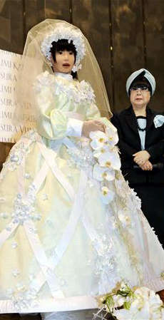 Bridal Robots - The HRP-4C Unit Walked Down the Aisle on a Runway in Osaka, Japan