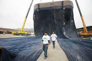 Peruvian Seamstresses Create 141 foot Tall Denim Pants