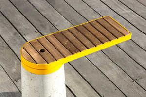 Kebony Cantilevered Bench Utilizes Compound Turning Soft Wood to Hard Wood