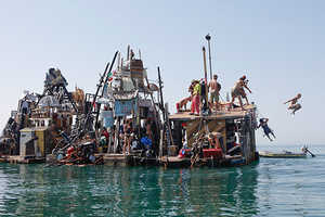 Artist Swoon Recycles Trash into a Floating Artist Community