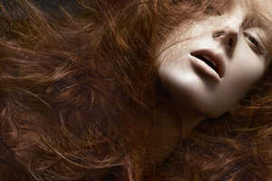 Model Olga Sherer Lets Her Wild Locks Loose