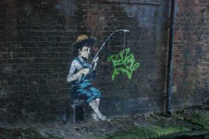 Graffiti Artist Banksy Tags on the River Banks