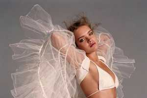 Natalia Vodianova Looks Angelic as She Flies Away in Fabric