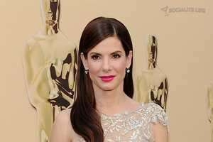 Sandra Bullock's Red Carpet Gown Channels the Oscar Award