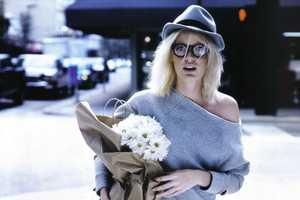 Caroline Wingberg Runs Around the City for Elle Italia April 2010