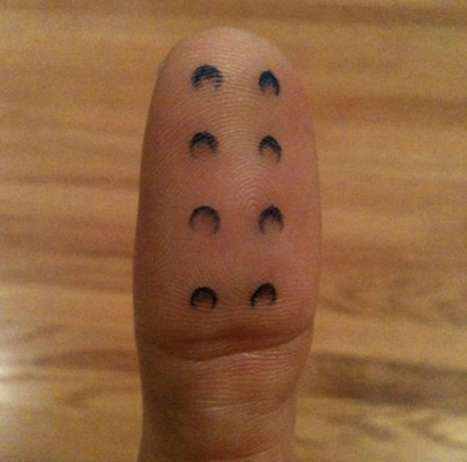 LEGO thumb tattoo