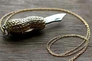 The Golden Peanut Pocket Knife Necklace is Dangerously Cute