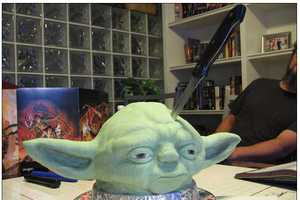 The Yoda Cake Head Gets a Massive Knife Through Its Brain