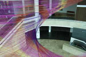 The Gravity's Loom Installation is a Winding Web of 30 Miles of Yarn