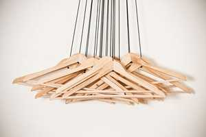 Alice Rosignoli Combines 20 Hangers for an Instant Closet and Art Installation