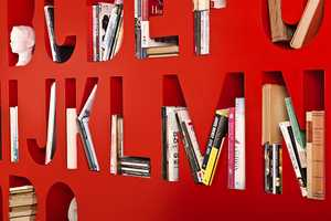 The  Aakkoset by Lincoln Kayiwa is an Alphabetized Shelf & Room Divider