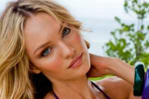The Candice Swanepoel Sauvage Swimwear '11 Lookbook will Warm You Up