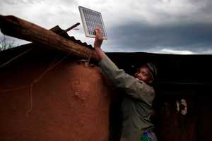 Solar Energy Lights African Huts and Changes Lives Far from the Grid