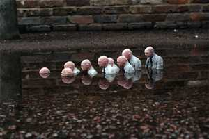 Isaac Cordal Creates Touching Scenarios with Mini Figurines
