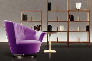 The Arabella Swivel Chair by Gioretti Brings Asymmetrical Splendor Inside