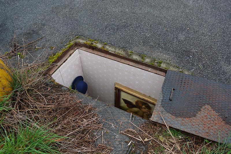 Abandoned Manhole Art