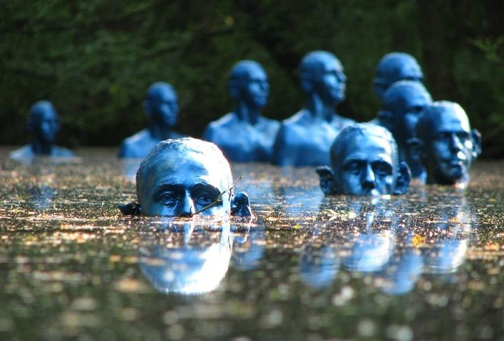 Poignant Sinking Statues