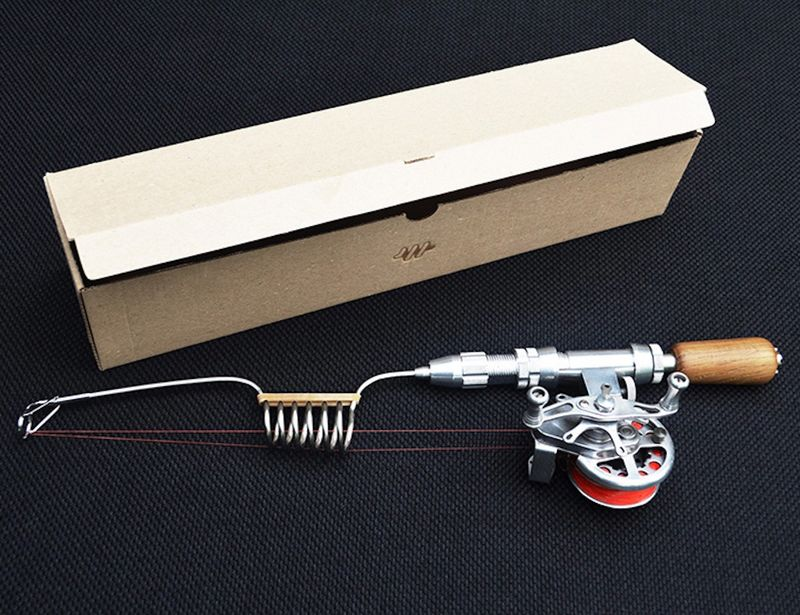 Luxury fishing poles compact fishing system by for Compact fishing rod
