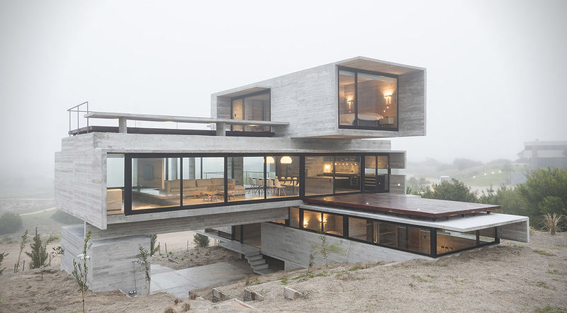 Modern golf retreats concrete block home for Concrete block house