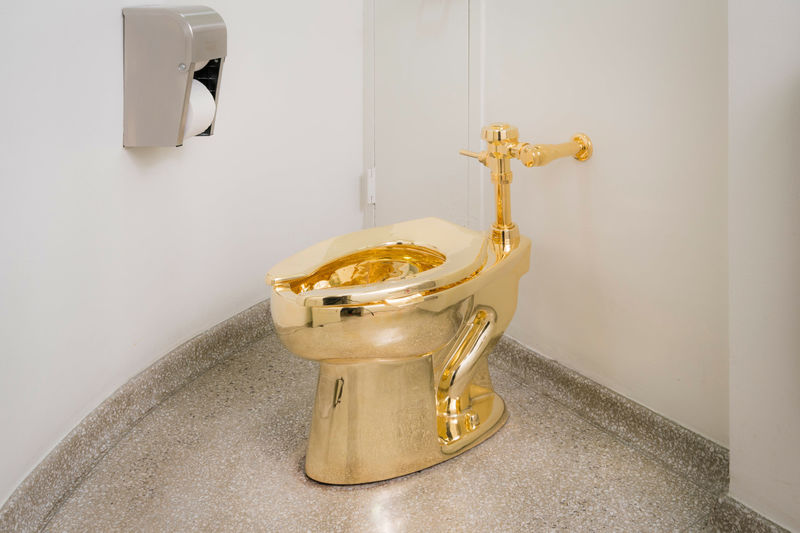 18-Karat Gold Toilets