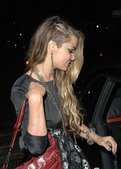 Check out pictures of Carmen Electra's half-shaved hair in the ...