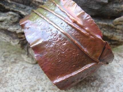 LadyMaduzaDZines folds Copper to resemble paper jewelry