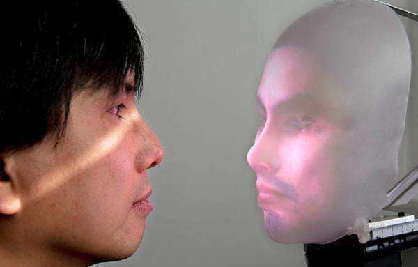 Realistic Projected-Face Robots