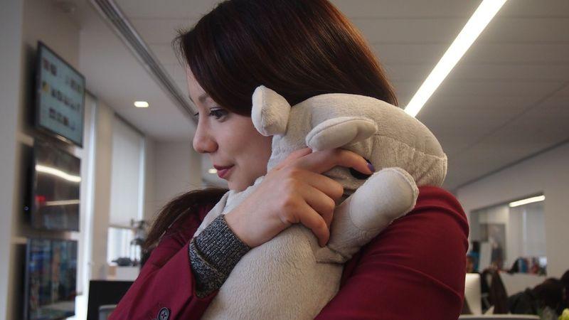 Hugging Stuffed Animals