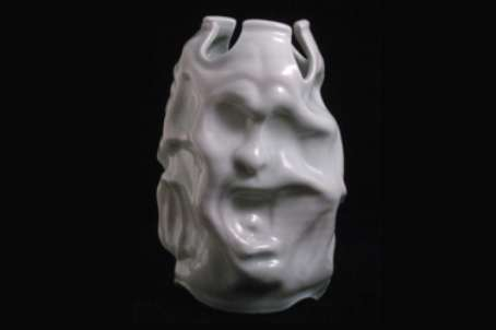 porcelain altered face vase