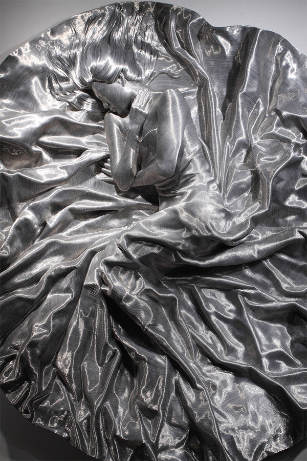 Meticulously Wrapped Metal Figurines