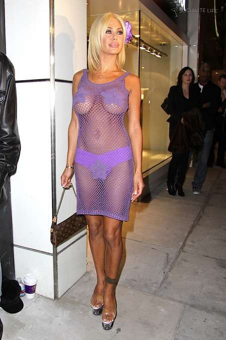 shauna sand wears a purple dress
