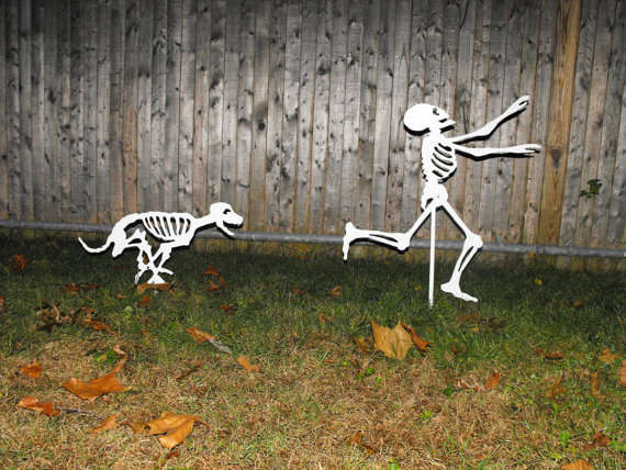 Cadaverous-Chasing Decorations - This Halloween Skeleton Yard