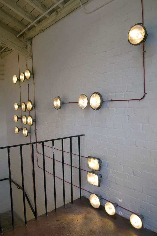 Recycled headlight murals staircase light installation for Mural lighting