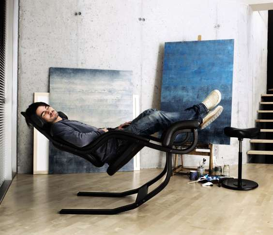 Stokke  the company who made all kinds of kneeling chairs  also made the  Gravity Balans. Kneeling Chair